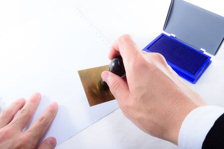 HAND IN SUIT STAMPING ON PAPER WITH WHITE ISOLATED BACKGROUND Stock Photo - 17689024