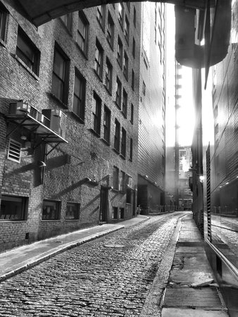 Black and white shot of an alleyway in Boston