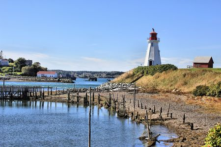 Harbor with a red and white lighthouse photo