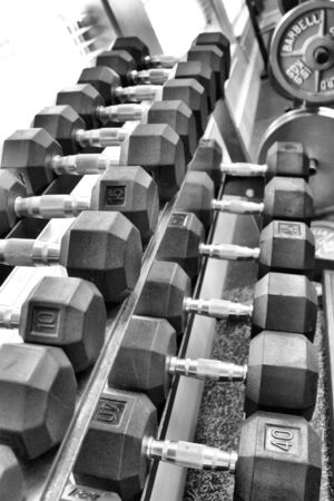 dumb: A row of dumb bells in black and white Stock Photo
