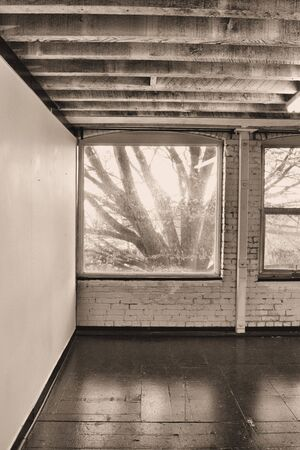empty warehouse: Empty room with window in sepia