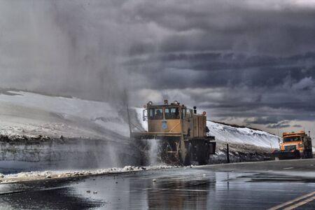 snow plow: Snow Plow plowing the road
