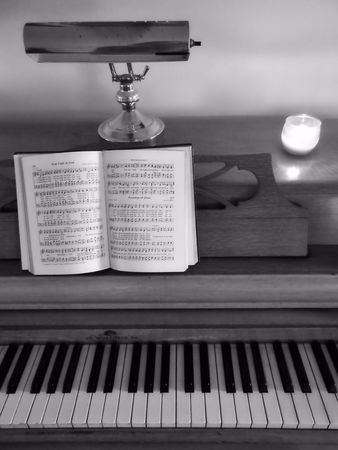 hymnal: Piano and music in black and white