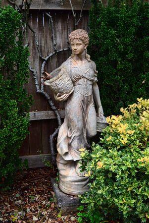 Statue in garden Фото со стока