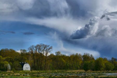 stormy clouds: Stormy clouds with white barn