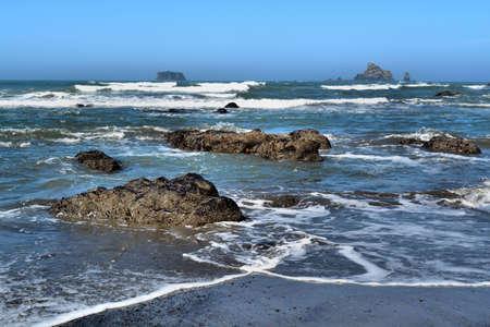 Rocky beach with ocean Stock Photo