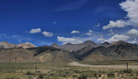 byway: Mountain range with blue sky Stock Photo