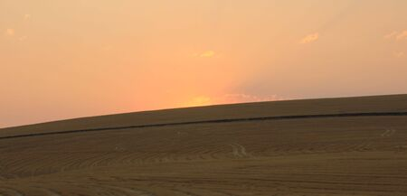 over hill: Wheat field and sunset over hill Stock Photo