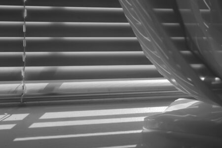 window treatments: Black and white shot of window sill and shadows
