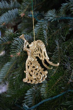 angel tree: Gold Angel Tree Ornament Stock Photo