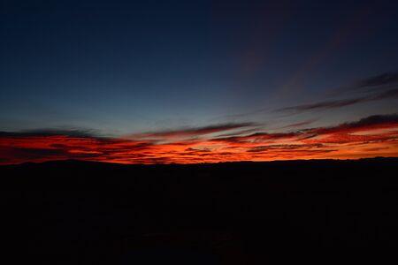 Orange sunrise strip across middle of frame