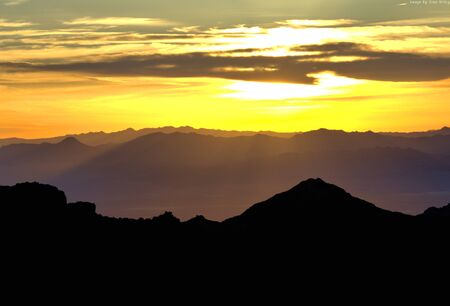 Sunrise with layers of mountain ranges