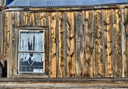 Old siding and window of wooden building. Reklamní fotografie