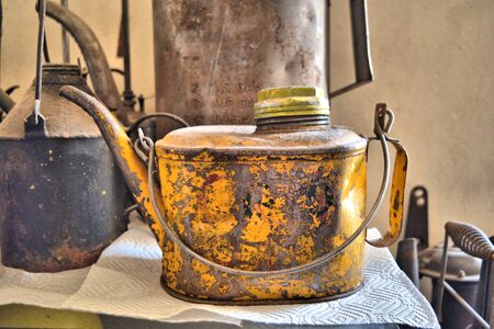 Rusted tin in yellow paint