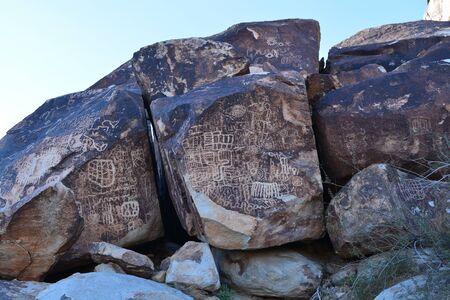 Petroglyphs on a rock face Stock Photo