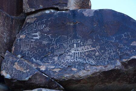 Petroglyphs on a rock in blue Stock Photo