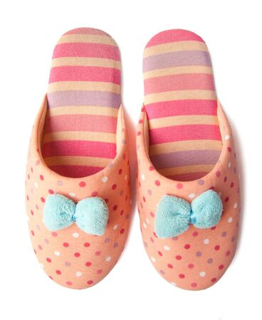 Cute pink striped girl's isolated slippers