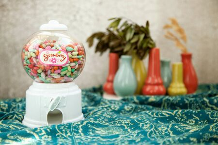 Bubble candy machine toy on a colorful background Stockfoto