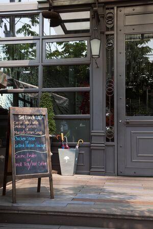 message board: Chalkboard menu outside the restaurant. Empty board menu in front of the cafe