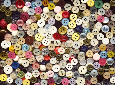 clothing buttons: Lot of colorful plastic clothing buttons. Many small round vintage buttons pattern background Stock Photo