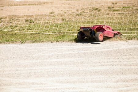 radio activity: Small radio controlled model car crashed off road. Miniature remote controlled buggy racing hobby Stock Photo