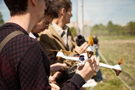 Khabarovsk, Russia - May 21, 2017: Quadcopter pilots at a drone racing. Young man holding a multicopter Publikacyjne