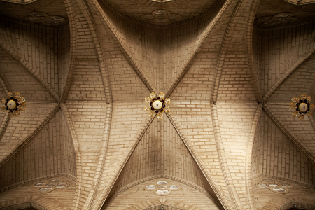Simple church brick ceiling with lamps. Abstract religious architecture background Stockfoto