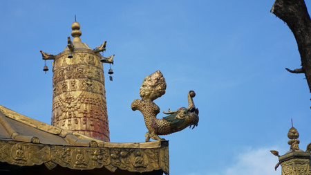 Brass statue on the roof with sky Stock Photo