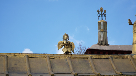 Brass statue on the roof with sky Editorial