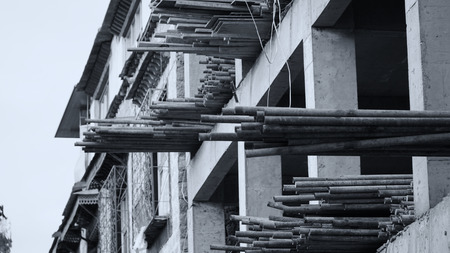 Construction work with some of wood and iron pipe on the upper floor Stock Photo