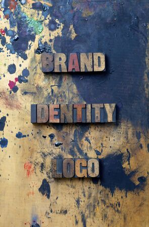 The words Brand Identity Logo written in antique letterpress printing blocks