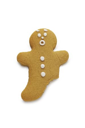 A surprised looking gingerbread man with a leg missing