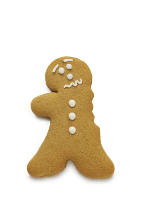 A concerned looking gingerbread man having just lost an arm Stock Photo