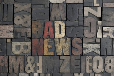 The words Bad News written in very old letterpress type photo