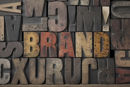 The word Brand written out in very old and worn letterpress type Stock Photo - 15580115