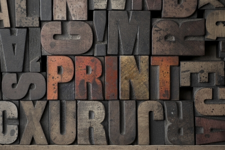 letterpress words: The word Print written in very old letterpress blocks Stock Photo