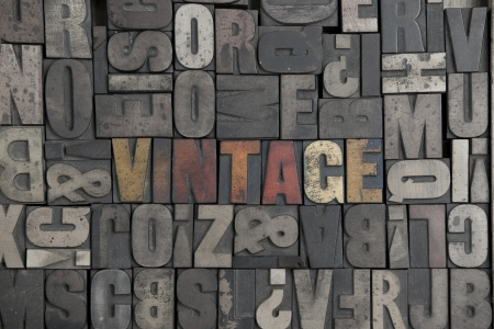 The word Vintage written in very old letterpress type photo