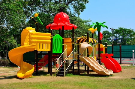 Modern children playground in park photo