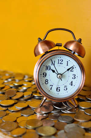 time money: alarm clock and coins