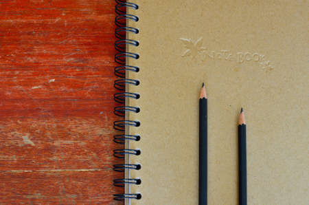 Black pencil and note book  photo