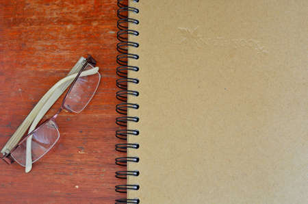 glasses and note book photo