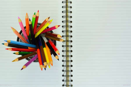 Various colour pencils and note book  photo