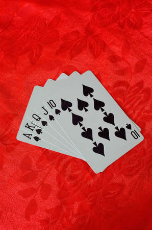 cards on red felt poker table background Stock Photo - 12512957