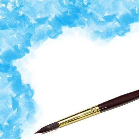 background with artists brush and blue watercolor painted photo