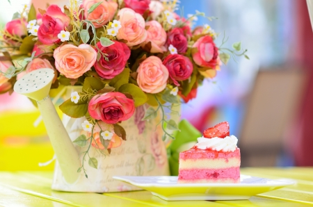 Strawberry cake with flowers on table photo