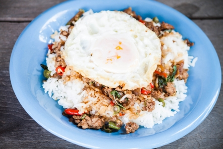 topped: Thai spicy food, rice topped with stir fried pork and basil with fried egg