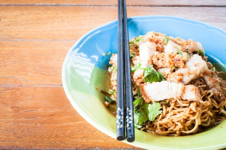 belly pepper: Stir fried spicy noodles with crispy pork and chopstick Stock Photo