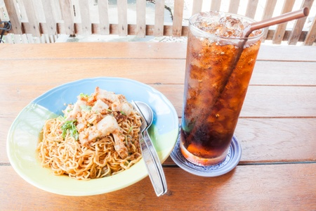 Easy meal with stir fried spicy noodles and cola photo