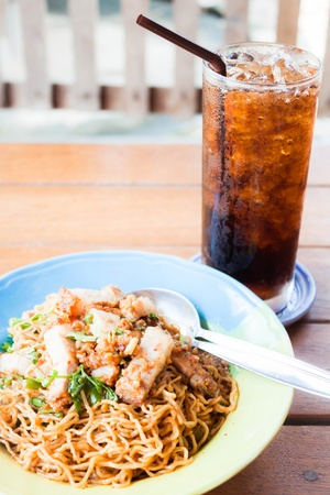 fast meal: Fast meal with stir fried spicy noodles and cola