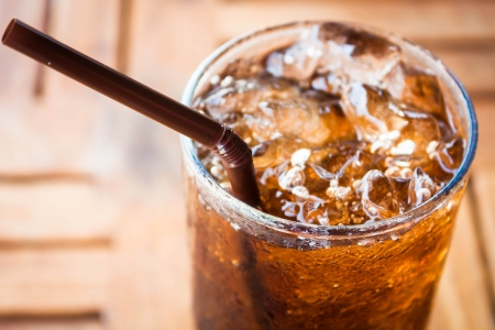 Cold glass with cola and ice cubes Stock Photo